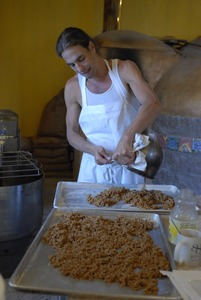 Thumbnail of Hungry Ghost Bread: owner and baker, Jonathan C. Stevens, preparing filling for         cinnamon rolls