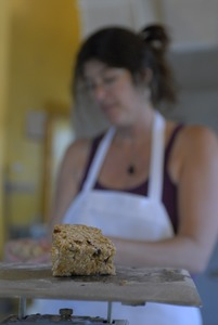 Thumbnail of Hungry Ghost Bread: owner and baker Cheryl Maffei weighing goods at a scale
