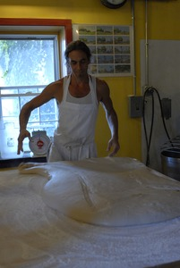Thumbnail of Hungry Ghost Bread: owner and baker Jonathan C. Stevens working dough for cinnamon rolls