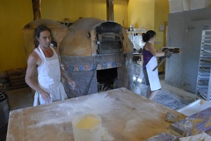 Thumbnail of Hungry Ghost Bread: owners and bakers Jonathan C. Stevens and Cheryl Maffei at             work near the bakery oven
