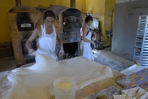 Thumbnail of Hungry Ghost Bread: owners and bakers Jonathan C. Stevens and Cheryl Maffei working pastry dough