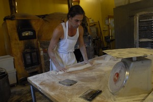 Thumbnail of Hungry Ghost Bread: baker Jonathan C. Stevens rolling out bread dough