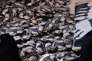 Thumbnail of Justice for Jason rally at UMass Amherst: buttons and fliers in support of Jason Vassell