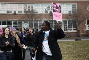 Thumbnail of Justice for Jason rally at UMass Amherst: protesters marching from the Student Union Building in support of Jason Vassell