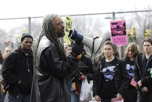Thumbnail of Justice for Jason rally at UMass Amherst: UMass professor Amilcar Shabazz             addressing protesters in support of Jason Vassell