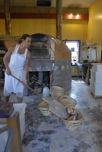 Thumbnail of Hungry Ghost Bread: owner and baker Jonathan C. Stevens with fresh-baked bread