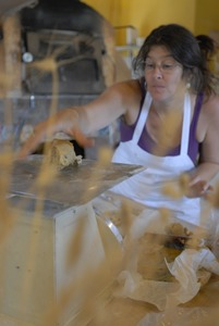 Thumbnail of Hungry Ghost Bread: owner and baker Cheryl Maffei weighing cookie dough