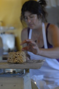 Thumbnail of Hungry Ghost Bread: owner and baker Cheryl Maffei weighing goods