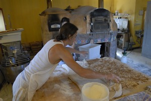 Thumbnail of Hungry Ghost Bread: owner and baker Jonathan C. Stevens working on cinnamon rolls