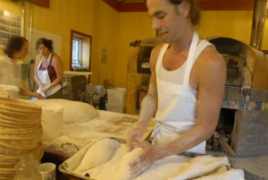 Thumbnail of Hungry Ghost Bread: owner and baker Jonathan C. Stevens preparing bread dough for proofing