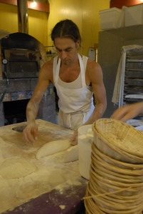 Thumbnail of Hungry Ghost Bread: owner and baker Jonathan C. Stevens preparing bread dough