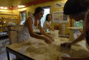 Thumbnail of Hungry Ghost Bread: owner and baker Jonathan C. Stevens and crew preparing bread dough