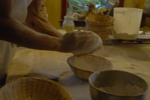 Thumbnail of Hungry Ghost Bread: baker shaping loaves for baking