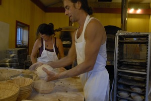 Thumbnail of Hungry Ghost Bread: owner and baker Jonathan C. Stevens shaping loaves for baking