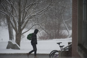 Thumbnail of Student trudging through the snow, UMass Amherst, during his book event