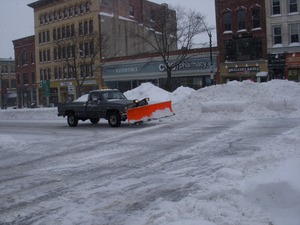 Thumbnail of Truck plowing on Main Street, Northampton, Mass., near Gothic Street, amid deep piles of plowed snow