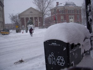 Thumbnail of Pedestrian crossing Main Street, Northampton, Mass., in heavy snow Unitarian Society and city building in background; snow-covered recycling bin         in foreground