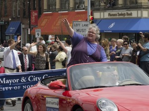 Thumbnail of Mayor Clare Higgins waving to the crowd from an automobile during the Pride             Parade; Main Street, Northampton, Mass.