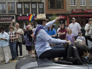Thumbnail of Grand Marshal Kate Clinton in her car during the Pride Parade; Main Street, Northampton, Mass.