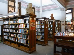 Thumbnail of Belding Memorial Library: interior with bookcases and busts