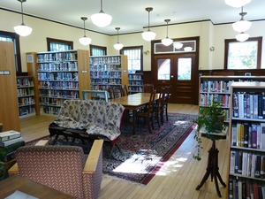 Thumbnail of Buckland Public Library: interior view of casual seating area and bookcases
