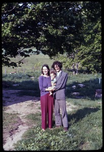 Thumbnail of Verandah Porche and Josiah Adams, with baby Oona, Montague Farm commune