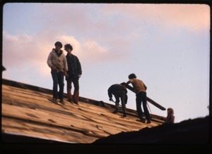 Thumbnail of Tony Mathews and crew roofing the barn, Montague Farm commune