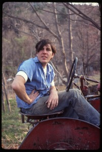 Thumbnail of Tony Mathews seated on a tractor, Montague Farm commune