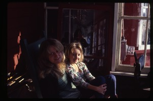Thumbnail of Janice Frey seated with daughter Sequoyah, Montague Farm Commune
