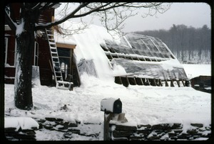 Thumbnail of Greenhouse and front of house under snow, Montague Farm Commune