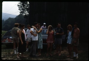 Thumbnail of Twentieth reunion gathering, Montague Farm Commune Communards gathered around parked cars, including Chuck Light, Karl Prinz, Dan and Nina             Keller, Sue Kramer and Tony Mathews