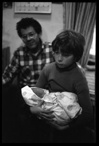 Thumbnail of Eben Light holding an infant, Dan Keller in background