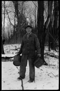 Thumbnail of Rob Ripley with buckets for tapping maple trees, near Montague Farm Commune