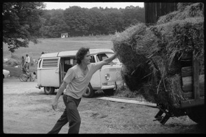 Thumbnail of Throwing hay bales on a truck, Montague Farm Commune