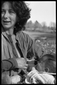 Thumbnail of Nina Keller preparing to feed her baby, Montague Farm Commune
