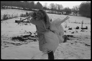 Thumbnail of Janice Frey with a turkey slung over her back, Montague Farm Commune
