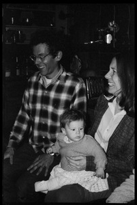 Thumbnail of Dan Keller and unidentified woman with a baby, Montague Farm Commune