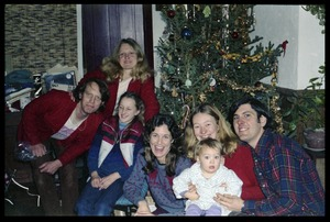 Thumbnail of Commune members in front of a Christmas tree, Montague Farm commune Includes (right to left): Tony Mathews, Susan Kramer, baby, Anna,             Sequoya Frey, Janice Frey, and Sam Lovejoy