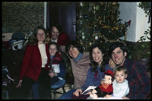 Thumbnail of Commune members in front of a Christmas tree, Montague Farm commune Includes (right to left): Tony Mathews, baby, Anna, Harvey Wasserman,             Sequoyah Frey, Sam Lovejoy, Janice Frey