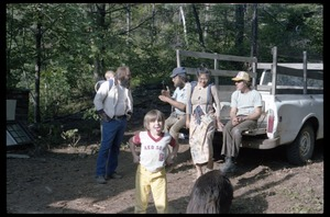 Thumbnail of Communards seated on the back of a pickup truck, awaiting a hike, Montague Farm commune