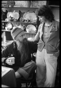 Thumbnail of Unidentified man, seated with coffee mug, talking with Nina Keller, Montague Farm commune