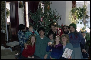 Thumbnail of Communards posed in front of the Christmas tree, Montague Farm commune Includes (rear row, l. to r.) Tony Mathews (with baby), Harvey Wasserman,             unidentified woman, Sam Lovejoy, unidentified man, Anna; front row (l. to r.):             Susan Kramer, Sequoya Frey, Janice Frey