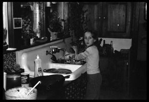 Thumbnail of Sequoya Frey at the kitchen sink, Montague Farm commune