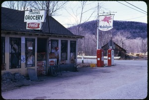 Thumbnail of Chapin's Grocery store Front entrance to the store with Mobilegas gasoline pumps