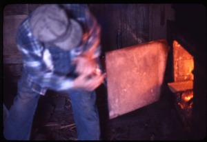 Thumbnail of Rob Ripley stoking a fire in his sugar house