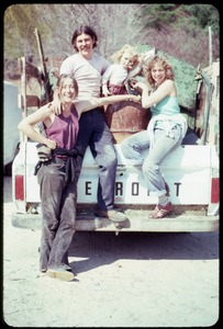 Thumbnail of Joan Marr, Tony Mathews, and Karen Guilette (l. to r.) seated on the back of a pickup truck, Montague Farm Commune