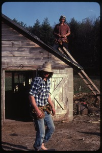 Thumbnail of Tony Mathews (on roof) and Smokey Fuller, roofing a shed, Wendell Farm