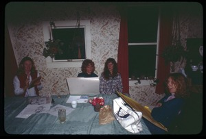 Thumbnail of Sue Kramer, Janice Frey, Judy, and Karen Guilette seated around a table, Montague Farm Commune