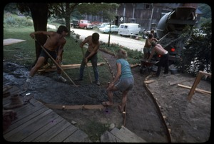 Thumbnail of Pouring a concrete walkway, Montague Farm Commune Left to right: Harvey Wasserman, Tony Mathews, Janice Frey, and Sam Lovejoy (back to camera)