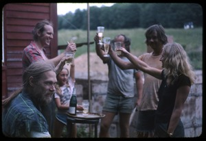 Thumbnail of Proposing a toast, Montague Farm Commune Left to right: Unidentified, Sam Lovejoy, Sequoya Frey, two unidentified men,         Janice Frey
